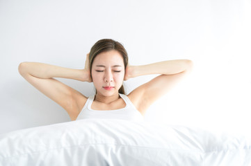 Asian beauty woman feel annoy alarm clock in white bedroom after wake up