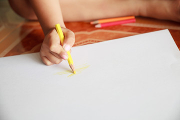 Girl drawing a picture in the room.