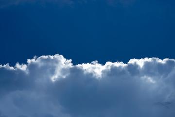 Rain cloud with blue sky background.