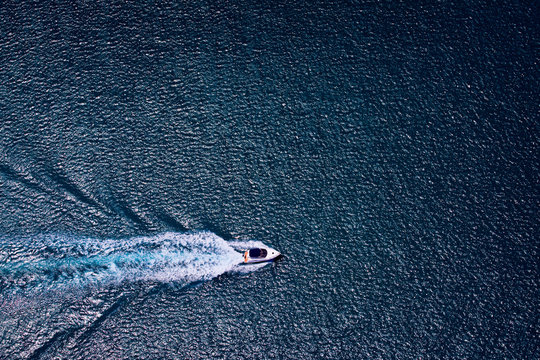 Aerial photograph of boat cruising on calm waters off the coast of Perth, Western Australia.