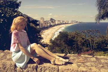 young woman and Ipanema beach in Rio de Janeiro behind