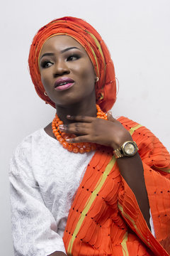 a young African lady in complete Yoruba attire