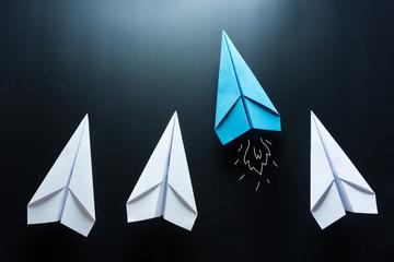 Blue paper plane leader concept