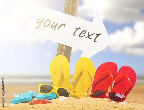 cc45436c5210 Summer vacation concept--Color Flipflops on a sandy ocean beach with arrow  sign
