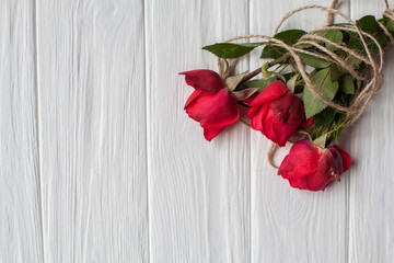 red roses isolated in white wooden background. flat lay. space for your text