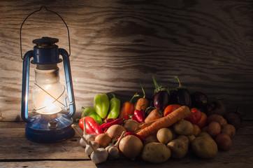 Vegetables lit by a kerosene lamp