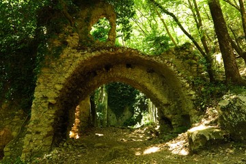 ruins of old paper mill in forest in Valle delle Ferriere, Amalfi Coast, Italy
