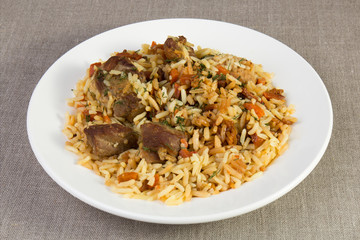 Pilaf - rice with meat and vegetables on the table