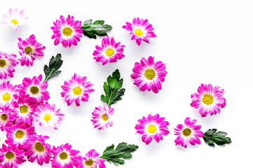 Floral pattern with pink flowers and leaves on white background top view