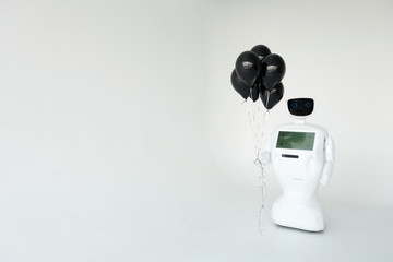 robot congratulates on the holiday, birthday. holds balloons in its hands. Happy Birthday. Cybernetic system today. Modern Robotic Technologies. Humanoid autonomous robot.