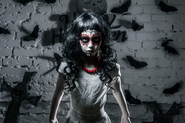 Little santa muerte girl with black curly hair is a great halloween character