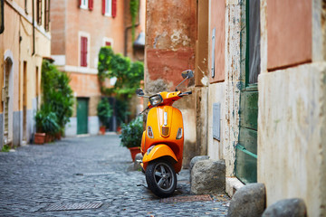 Old fashioned motorbike on a street of Trastevere, Rome