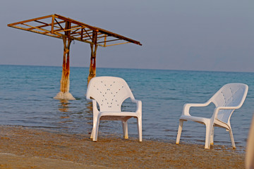 dead sea, the coast is covered with white rock salt