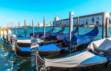 gondolas are berthed along the Grand canal in Venice. Italy