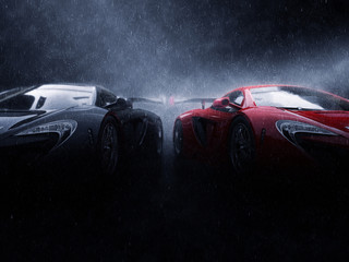 Great black and red super cars side by side in the rain