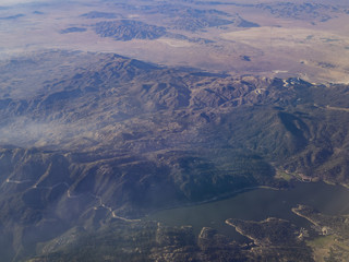 Aerial view of San Bernardino Mountains and Big Bear Lake, view from window seat in an airplane