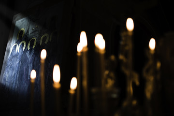 Orthodox icon and candles faith worship, religion concept