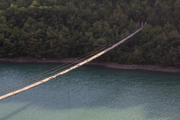 Albania: Decaying Hanging bridge with loose wires
