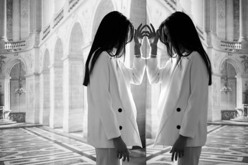 Woman and her reflection