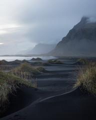 Dusk over black sand dunes in Stokksnes