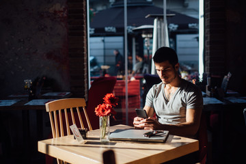 Man using a laptop in a cafe