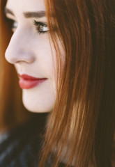 young woman with red hair in closeup