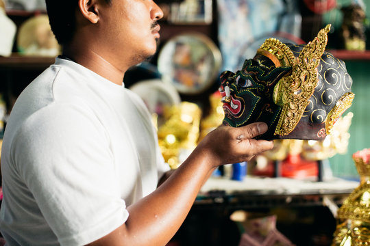 Artist holding 'Hua Khon' traditional mask for Thai performing arts