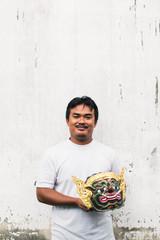 Artist holding Thai traditional mask for 'Khon' Traditional dance of the Ramayana Saga