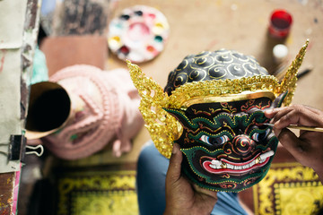 Artisan painting 'Hua Khon' traditional mask for Thai performing arts