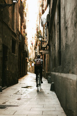 Back view of a woman riding her bike on the street.