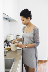 African girl preparing coffee in the kitchen