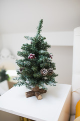 Mini Christmas tree on a white table