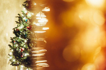 Christmas tree half hidden by blurred lights