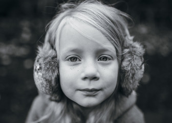 Portrait of A Little Girl with Earmuffs