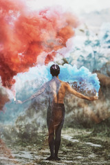 Ballet dancer with smoke bombs