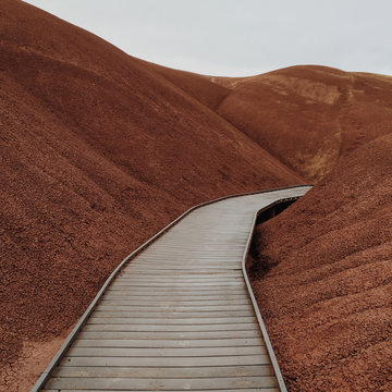 Pathway through red clay hills