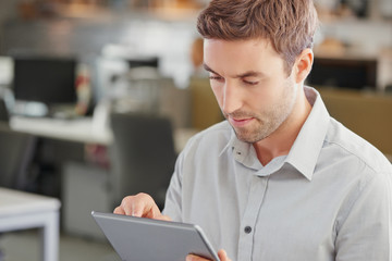 Close-up of businessman using a digital tablet