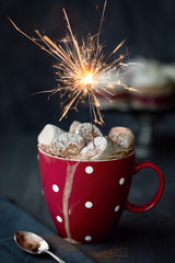 Hot chocolate with marshmallows and sparkler