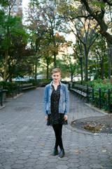 Beautiful, stylish woman standing in park