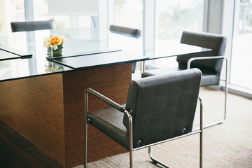 Glass desk and  office chairs in a meeting room
