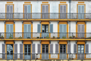 Colourful facade with balconies