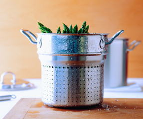 Pot with asparagus in steamer basket