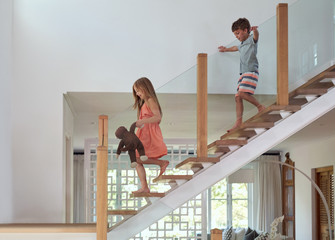 Kids running down staircase
