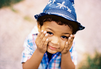 Playful mixed race young boy