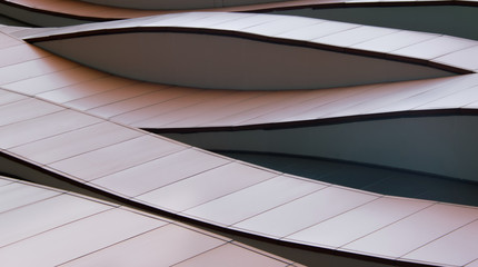 Abstract curved line details on building exterior.