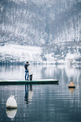 Couple on a lake at winter
