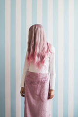 Fashionable young woman with pink hair