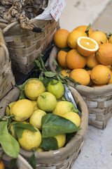 Baskets of oranges and lemons outside a store