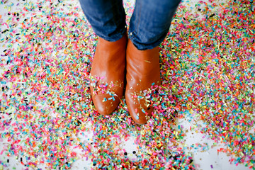 Brown boots standing in confetti