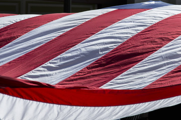 Close-up of an American Flag in a holiday parade